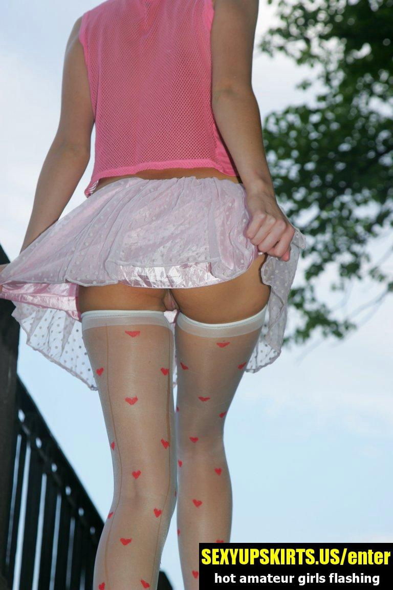 White skirt of gal in stockings hardly covering her upskirt - sexy upskirt photos